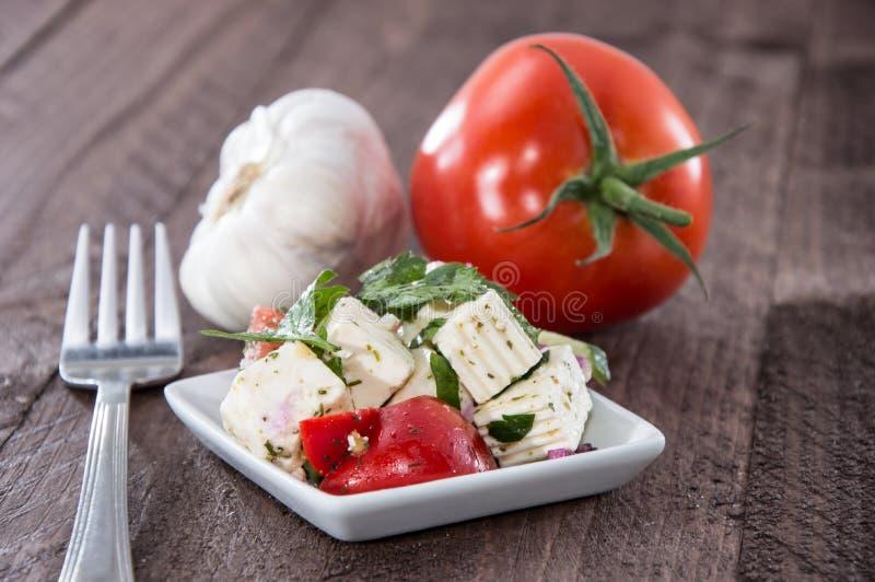 Fetaost med tomaten fotografering för bildbyråer