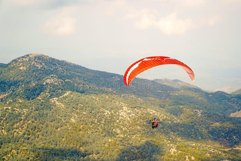 Paraglider flying just after jump on Babadag. Fethiye, Mugla/Turkey- August 19 2018: Paraglider flying just after jump on Babadag royalty free stock photo