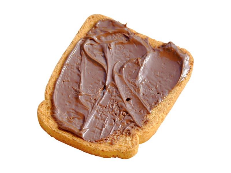 Fetta biscottata con la crema del cacao fotografia stock