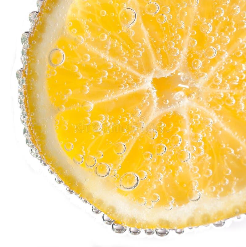 Fetta del limone con le bolle immagine stock libera da diritti