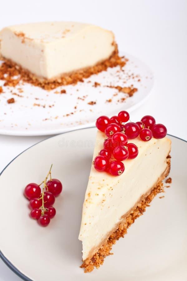 Fetta della torta di formaggio della vaniglia immagini stock libere da diritti