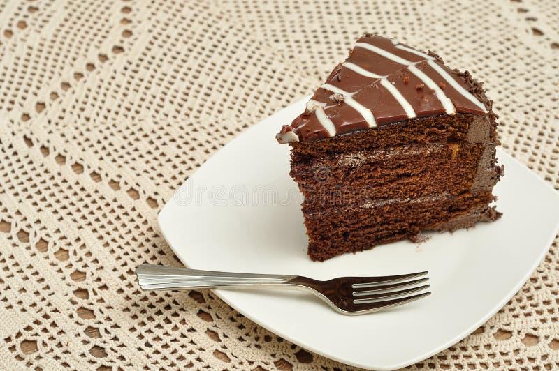 Fetta di dolce di cioccolato con una forcella del dolce immagine stock libera da diritti