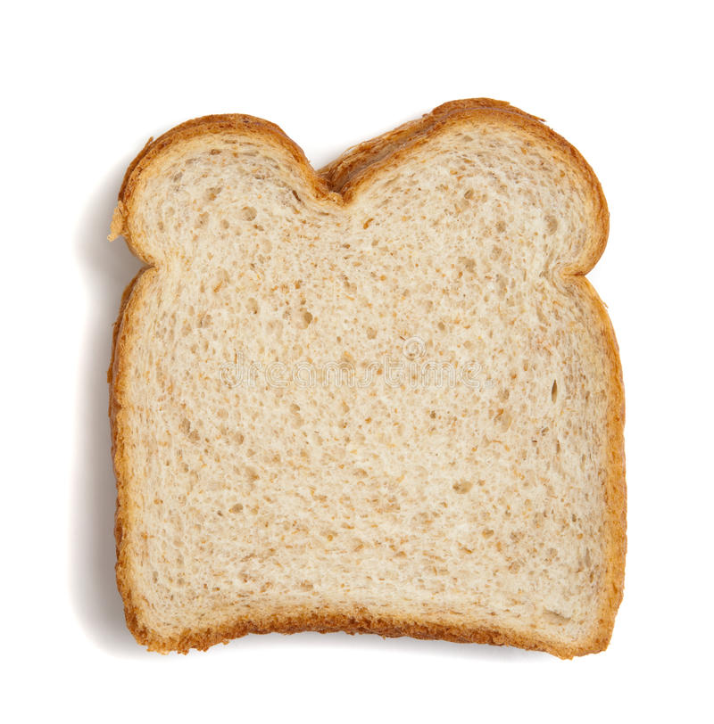 Fetta di pane del frumento su una priorità bassa bianca immagini stock libere da diritti