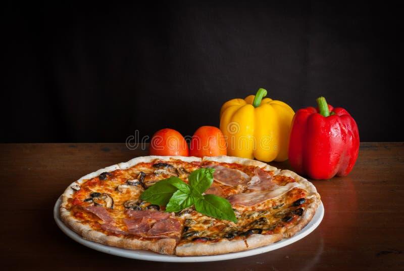 Fetta di quattro stagioni della pizza fotografia stock libera da diritti