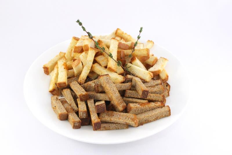Fette biscottate con i condimenti e l'aglio immagini stock libere da diritti