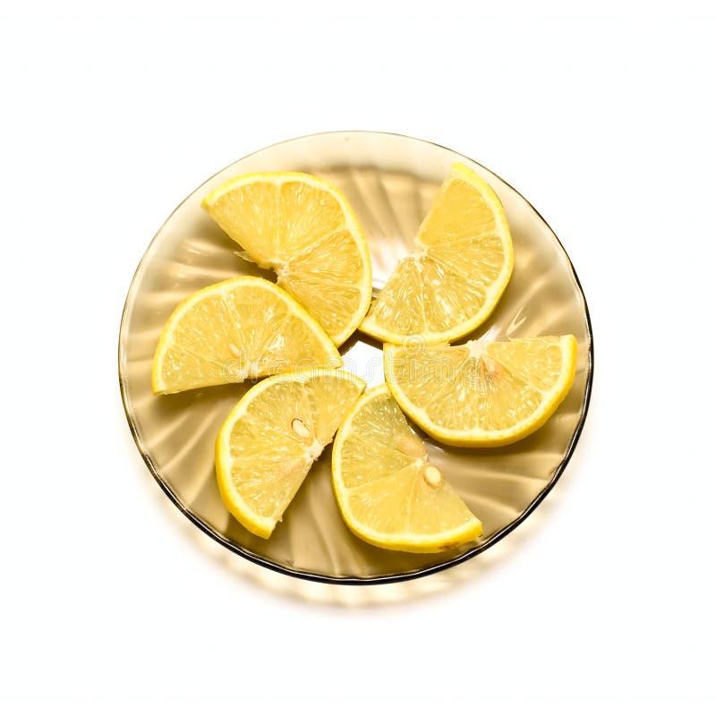 Fette del limone sulla zolla fotografia stock