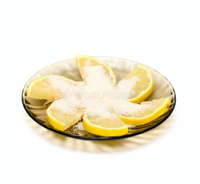 Fette del limone sulla zolla immagine stock