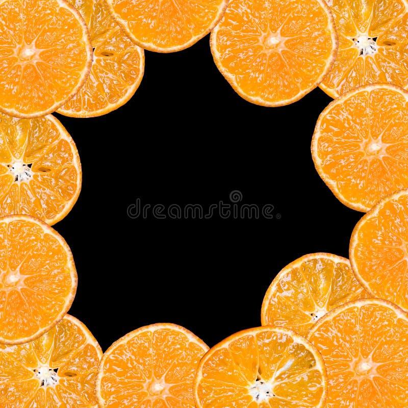Fette della frutta su un fondo nero immagine stock