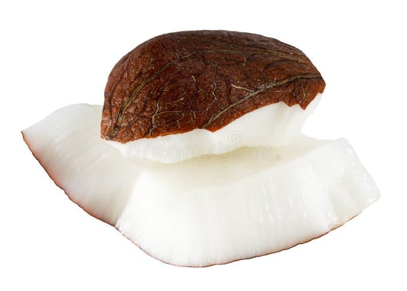 Fette della noce di cocco isolate su un fondo bianco fotografia stock