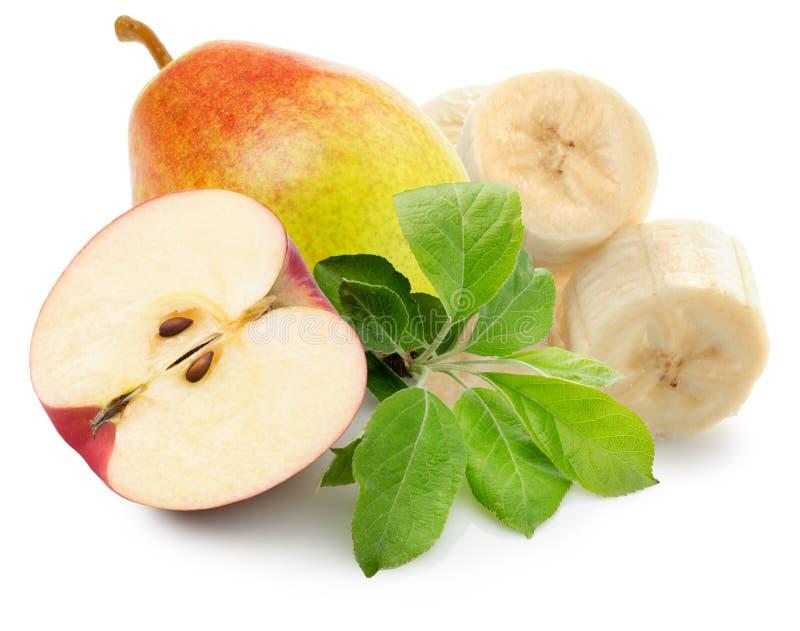 Fette di Apple, della pera e della banana isolate sui precedenti bianchi fotografia stock