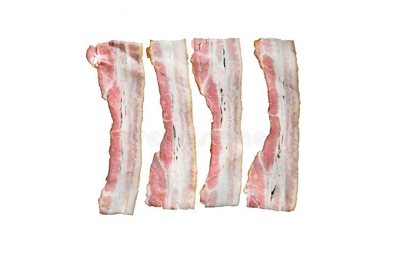 Fette di bacon fritto fresco in una pentola su un fondo bianco immagine stock libera da diritti