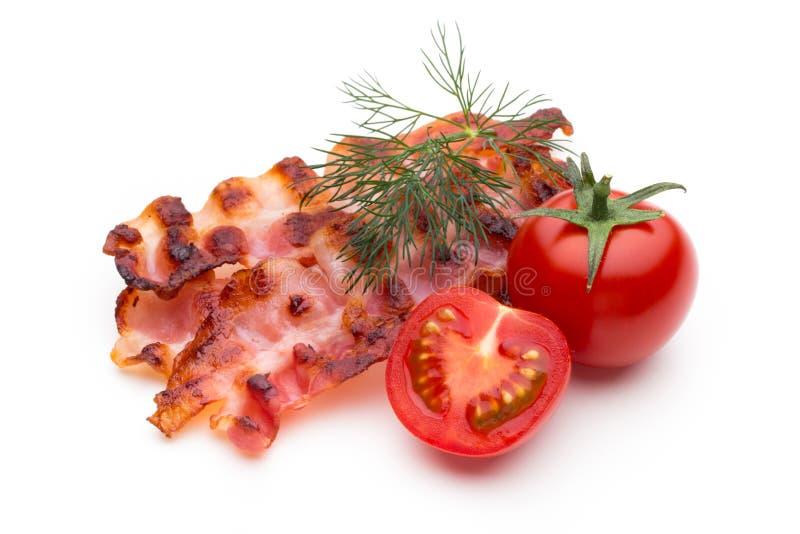 Fette di lardo cucinate del bacon su bianco fotografia stock