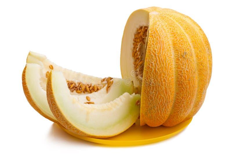 Fette di melone maturo su un piatto giallo fotografie stock libere da diritti