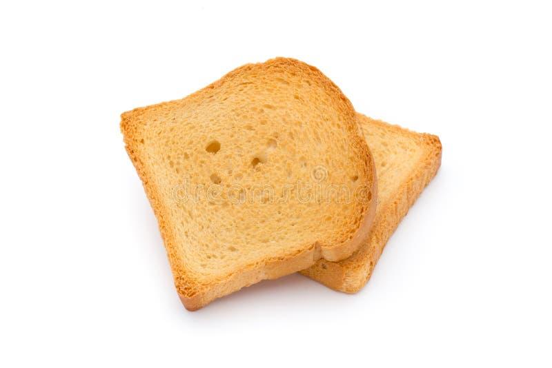 Fette di pane del pane tostato sulla tavola di legno, vista superiore immagine stock