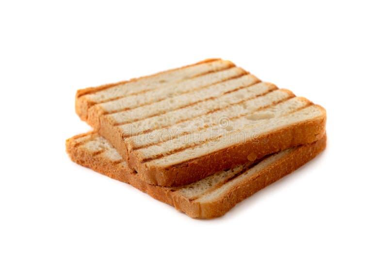 Fette di pane del pane tostato grigliate con una crosta dorata fotografie stock libere da diritti