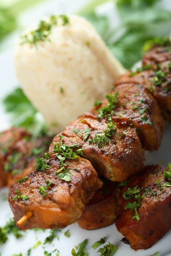 Fette di porco con riso fotografia stock