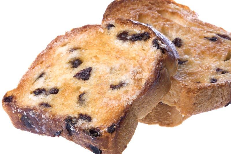 Fette tostate del pane di uva passa isolate fotografie stock