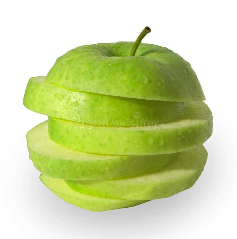 fette verdi della mela fotografie stock