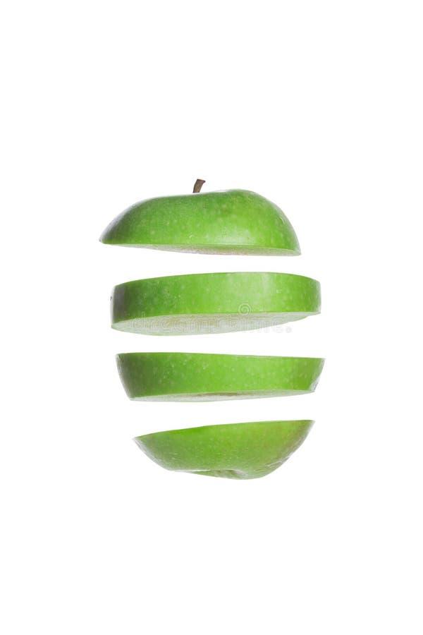 Fette verdi di galleggiamento di Apple fotografia stock libera da diritti