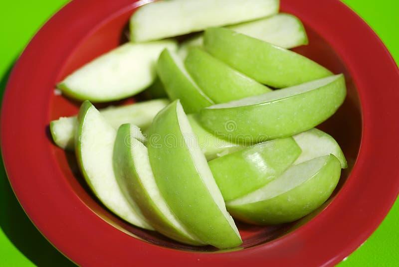 Fette verdi sane della mela fotografia stock libera da diritti