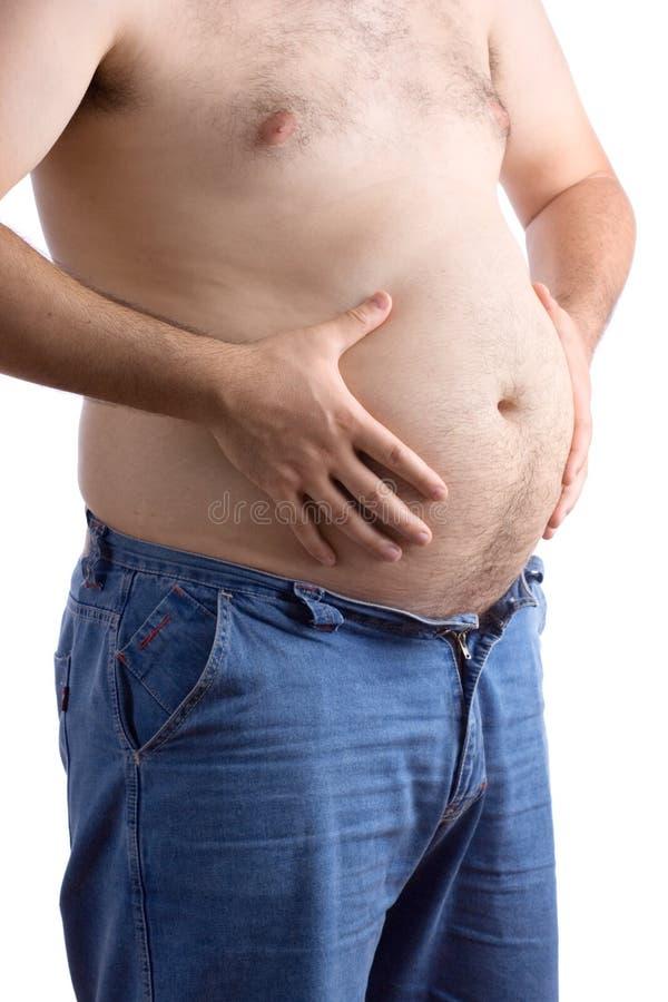 Fetter Kerl, der seinen großen Bauch anhält lizenzfreies stockbild