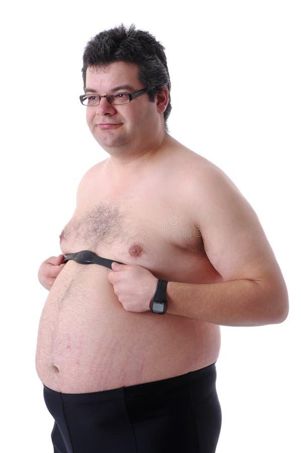 Fetter Mann, der Training tut stockbilder