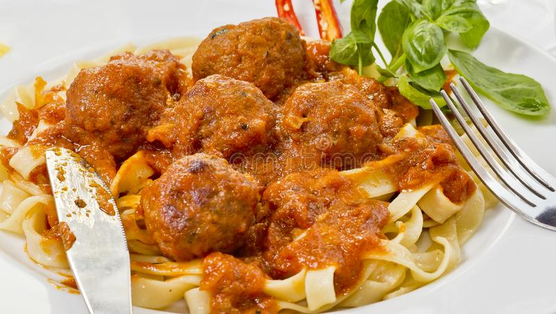 Fettuccine and Meatballs on a fork close-up stock photos