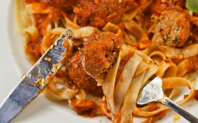 Fettuccine and Meatballs on a fork close-up stock photo