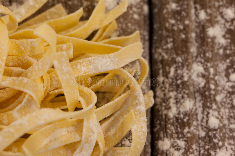 Fettuccine pasta dusted with flour royalty free stock image