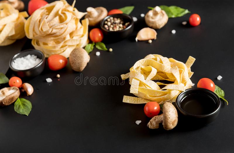 Fettuccine tagliatelle paste with herbs, spices royalty free stock photos