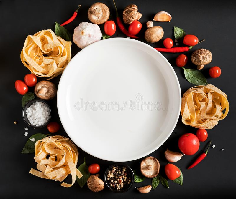 Fettuccine tagliatelle paste with herbs and spices with white pl stock photos