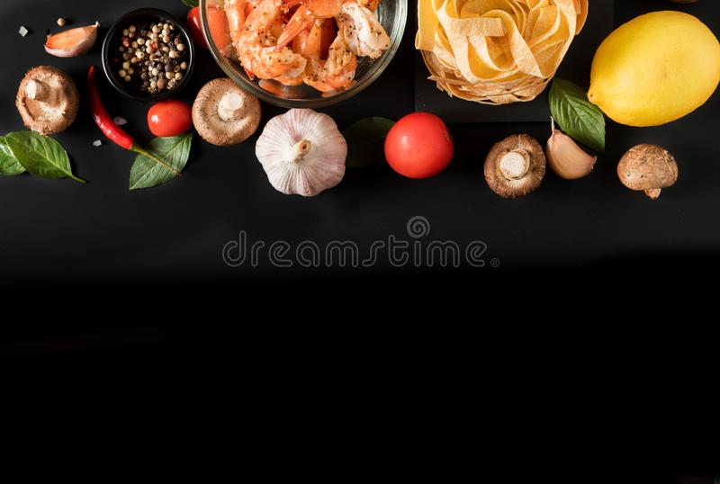 Fettuccine tagliatelle paste with prawns shrimps, herbs and spic royalty free stock photo