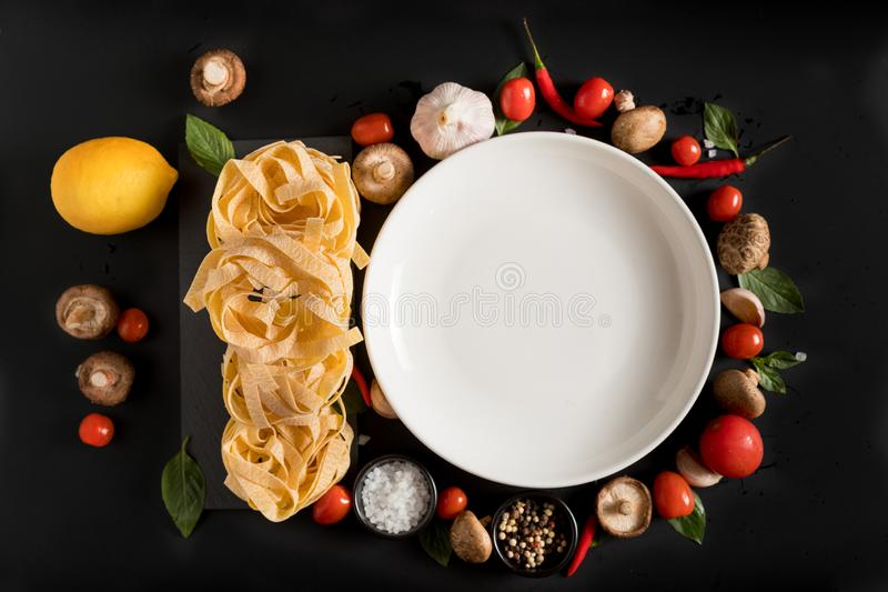 Fettuccine tagliatelle paste and white plate with mushrooms, her stock photos