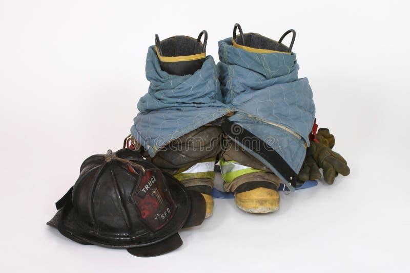Feuer-Matten und Sturzhelm stockbilder