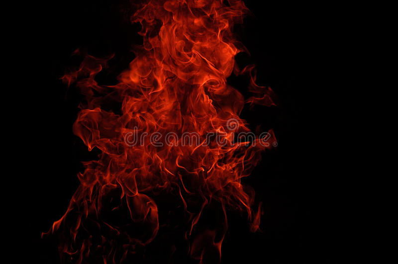 Feuerflammen im Schwarzen stockbild