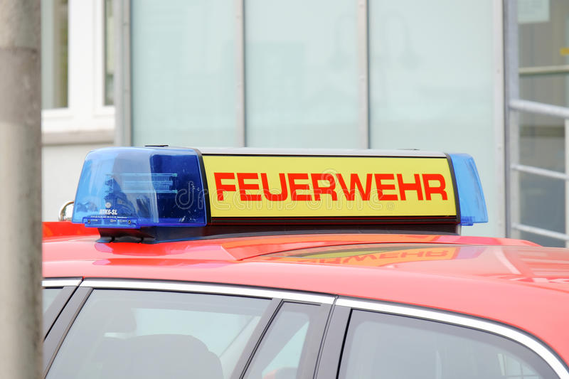 Feuerwehr. Emergency lights on top of a car of the german fire department stock photography