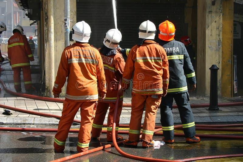 Feuerwehrmänner stockfotografie