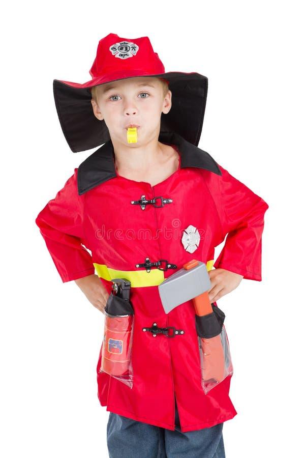 Feuerwehrmann des kleinen Jungen lizenzfreie stockbilder