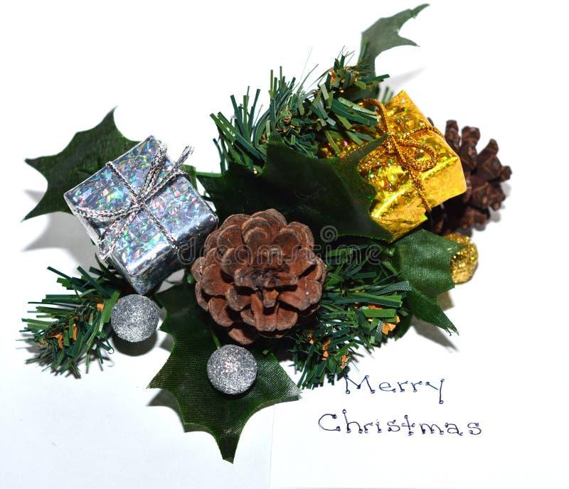 Feuillage de Noël avec la note de Joyeux Noël image stock