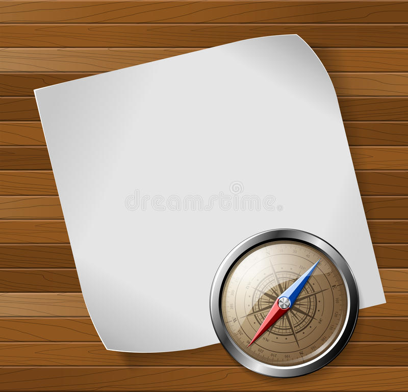 Feuille de boussole et de papier au-dessus de fond en bois illustration libre de droits