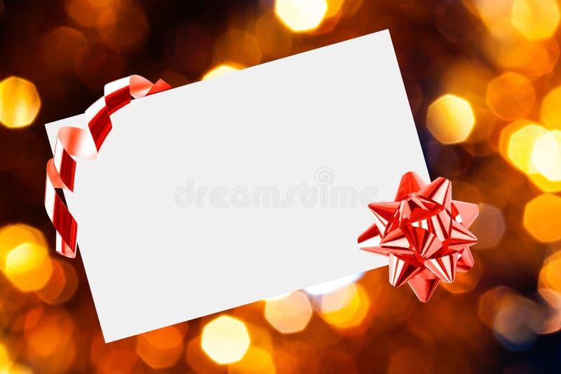 Feuille de Noël de papier avec l'arc photographie stock libre de droits