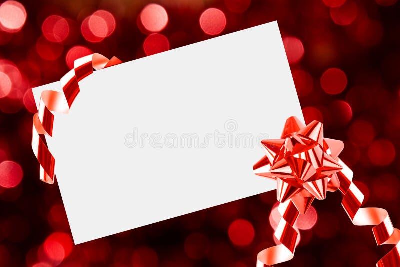 Feuille de Noël de papier avec la proue et les bandes photos stock