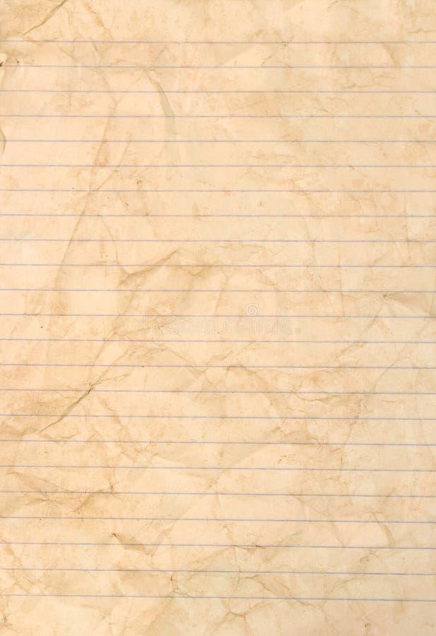Feuille de papier rayé souillé photographie stock