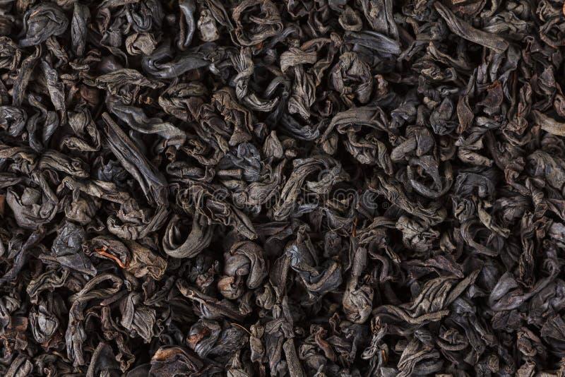 Feuilles sèches de thé noir Macro, fond image stock