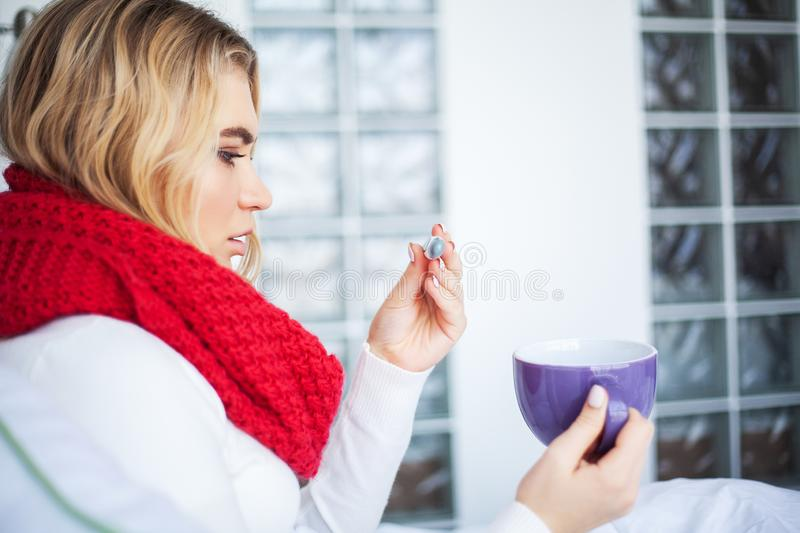 Fever And Cold. Portrait Of Beautiful Woman Caught Flu, Having Headache And High Temperature. Closeup Of Ill Girl. Covered In Blanket, Feeling Sick Holding royalty free stock photos