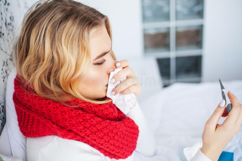 Fever And Cold. Portrait Of Beautiful Woman Caught Flu, Having Headache And High Temperature. Closeup Of Ill Girl. Covered In Blanket, Feeling Sick Holding stock image