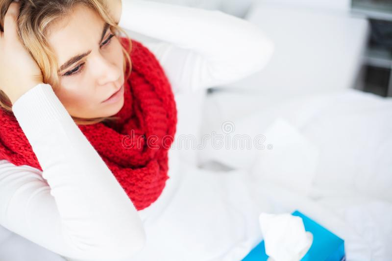 Fever And Cold. Portrait Of Beautiful Woman Caught Flu, Having Headache And High Temperature. Closeup Of Ill Girl. Covered In Blanket, Feeling Sick Holding royalty free stock photography