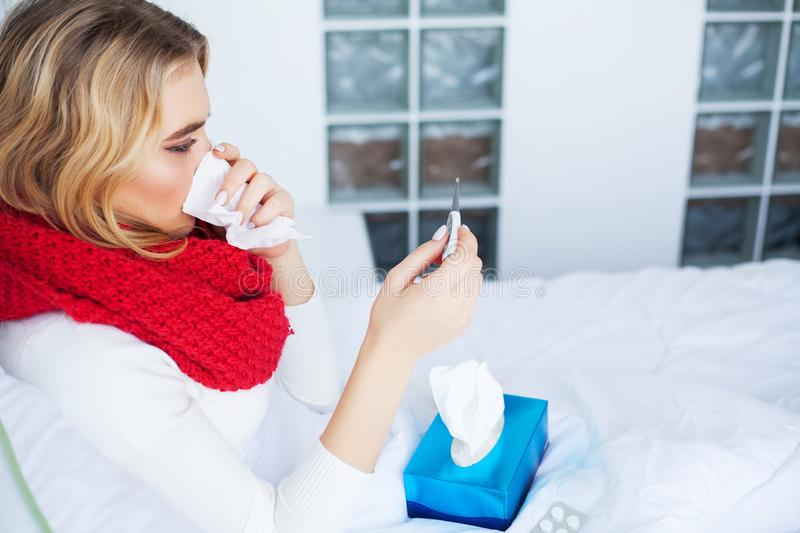 Fever And Cold. Portrait Of Beautiful Woman Caught Flu, Having Headache And High Temperature. Closeup Of Ill Girl. Covered In Blanket, Feeling Sick Holding stock photos