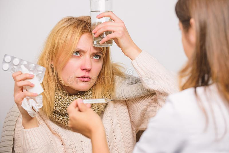 Fever and flu remedies. Woman consult with doctor. Doctor communicate with patient recommend treatment. Doctor ask royalty free stock images