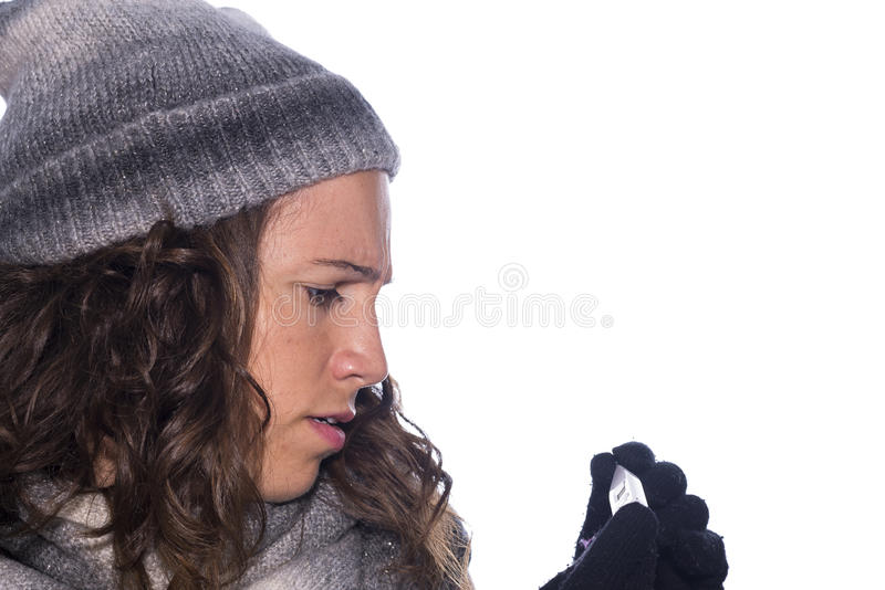Fever. Girl measuring the temperature with a thermometer royalty free stock images